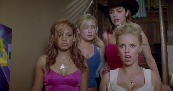four girl standing in staircase looking confused, cheerleading movie