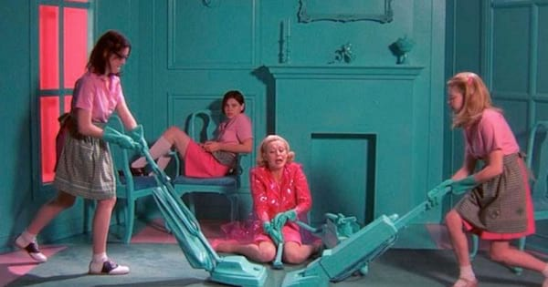 girls dressed in pink vacuuming a blue house