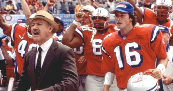 football team on field wearing orange with coach yelling in the replacements, cheerleading movies