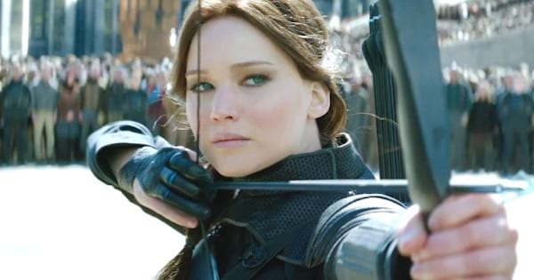 katniss everdeen using bow and arrow in the hunger games, movies books
