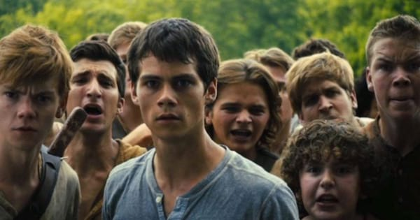 kids in the maze runner looking scared in a jungle, movies books
