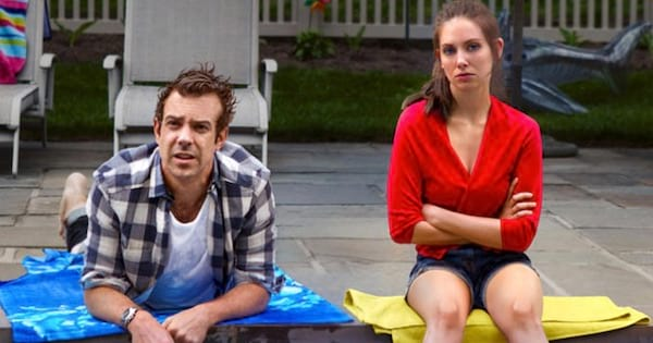 man and woman sitting on side of pool, movies