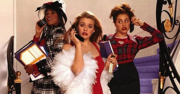 stars of clueless posing on staircase, movies