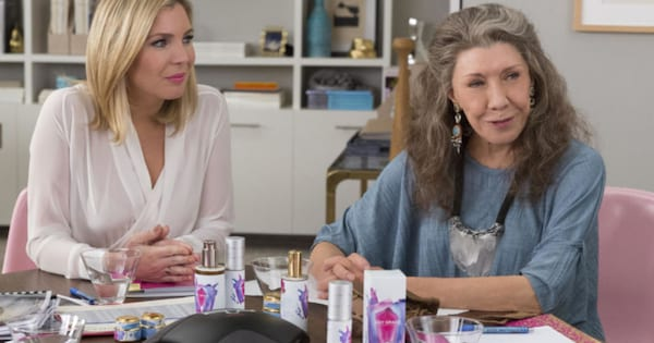 Frankie in a meeting about her lube in an episode of Grace and Frankie