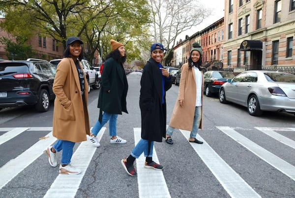 The women of The Fourtress crossing a street together in NYC