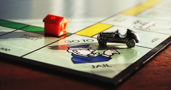 Monopoly Instagram Captions, a closeup of a Monopoly game board, family