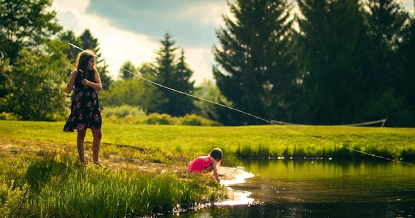 Fishing Instagram Captions, two young white girls fishing outside on a sunny day, fitness