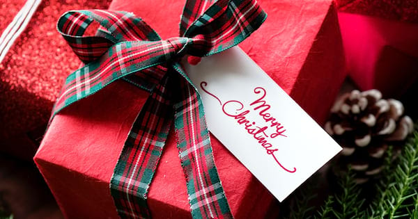 White Elephant Gift Ideas, closeup of a Christmas gift wrapped in red paper, family