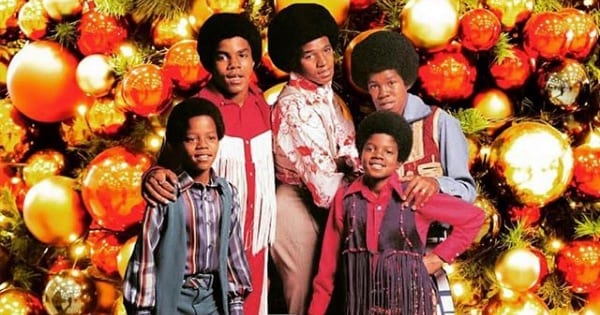 the jackson 5 posing in front of a christmas ornament background, Christmas songs
