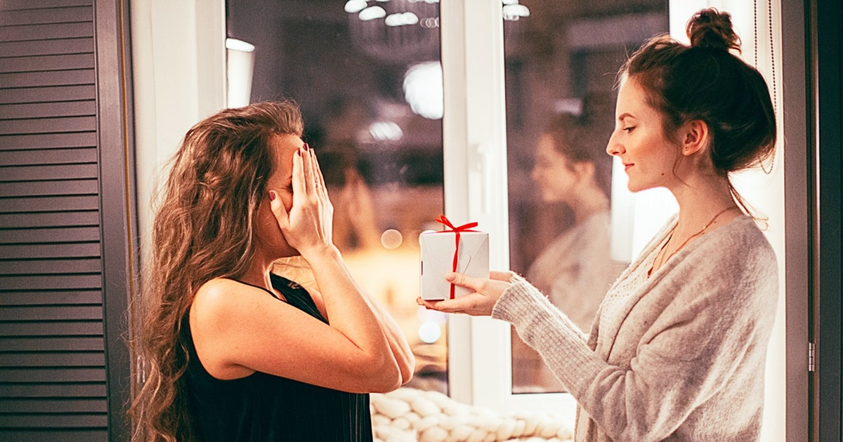 Gift Ideas For Someone You Don't Know, photo of two white women exchanging a gift