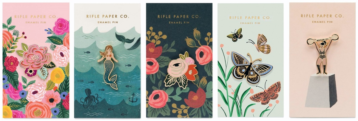 Gifts For Someone You Don't Know, five enamel pins, including two flowers, a mermaid, a butterfly, and a strong woman