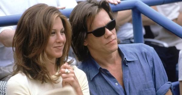 jennifer aniston sitting with man in bleachers, romantic comedy movies
