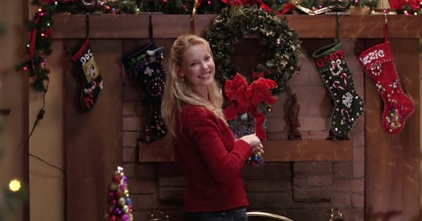 izzie stevens standing by the christmas stockings smiling on grey's anatomy season 2
