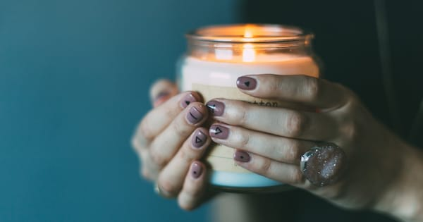 Woman holding a lit candle