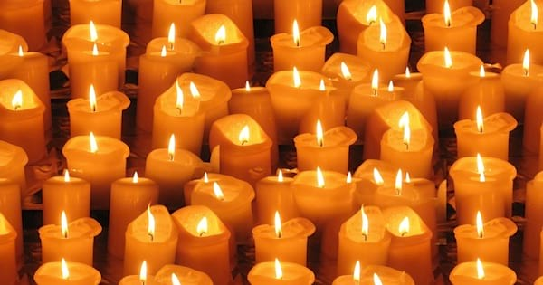 lit candles lines up burning