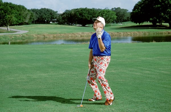 Rodney Dangerfield cursing at the sky in Caddyshack
