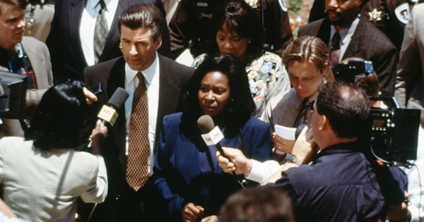 alec baldwin and whoopi goldberg in ghosts of mississippi dressed up for court with reporters holding microphones to them, southern movies