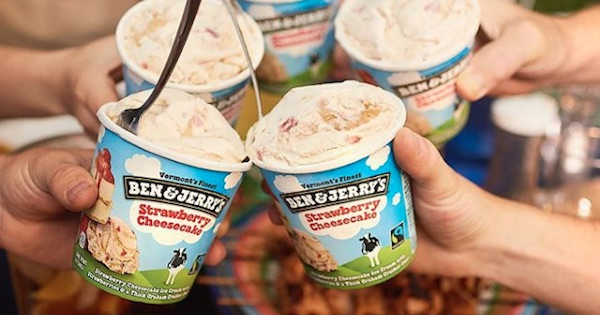 people holding pints of ben and jerry's strawberry cheesecake ice cream