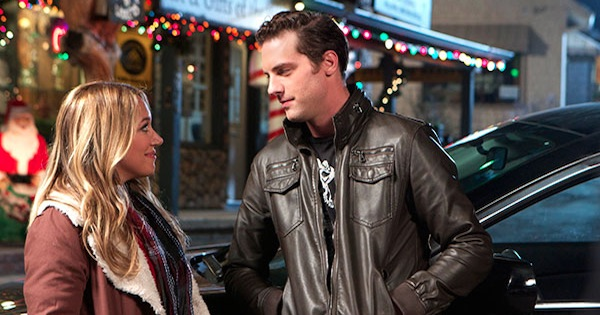 man and woman standing outside in the cold in naughty and nice movie, hallmark