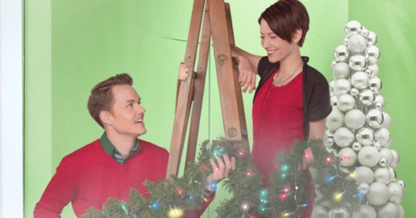 sloan and jake looking at each other smiling while decorating for christmas in window wonderland, hallmark movies