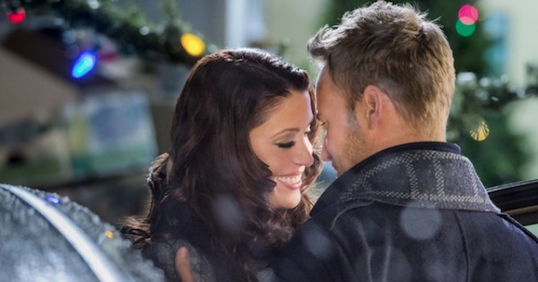 nikki and chris holding each other close smiling about to kiss in catch a christmas star, hallmark movie
