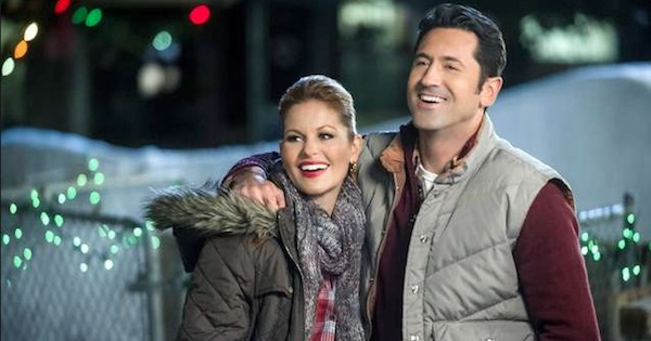 man and woman standing outside dressed warm smiling and laughing, hallmark movies