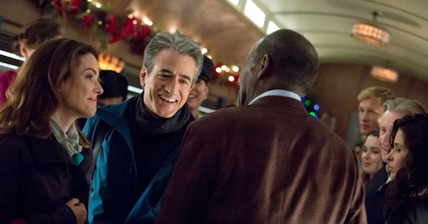 woman and two men smiling in the christmas train, hallmark movies