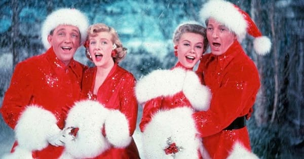 four singers smiling in white christmas movie, bing crosby