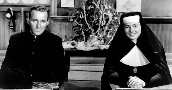 sister mary and father o'malley sitting at a table together smiling, bing crosby movies