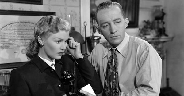 bing crosby as jim pearson with a woman in black and white, movies