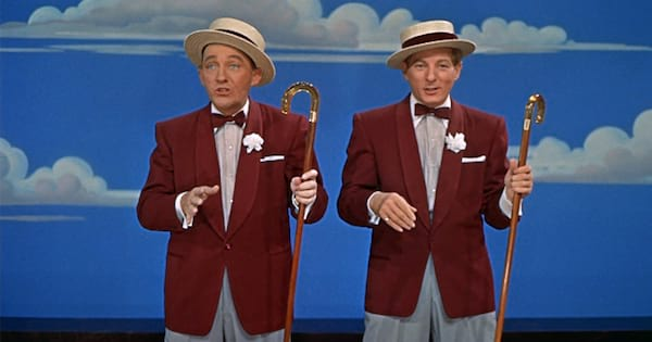 bing crosby performing on stage with another man, movies