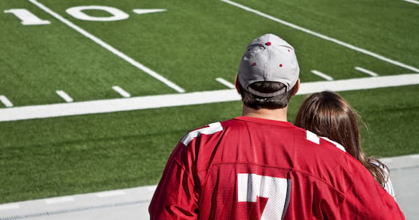 Couple at a football game