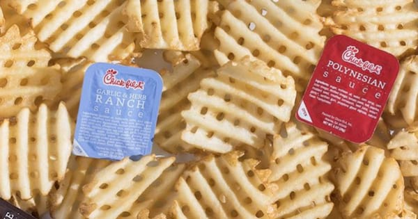 Chick-fil-A sauces surrounded by their waffle fries
