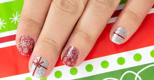 Woman showing off her holiday-inspired nail art