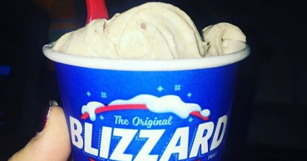 woman hand holding snickerdoodle dairy queen blizzard