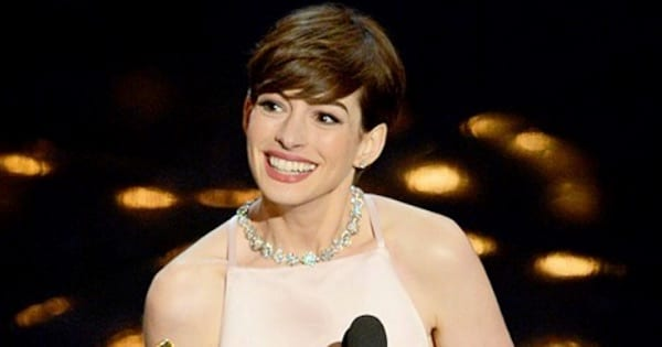 anne hathaway smiling on stage
