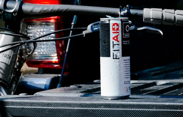 FitAid drink sitting on the back of an open truck bed