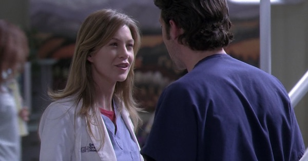 Meredith and Derek talking in the hospital on grey's anatomy