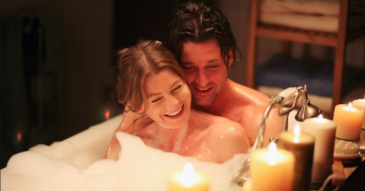Meredith and Derek in the bathtub smiling and laughing in grey's anatomy