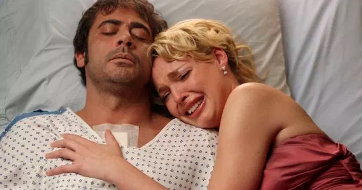 izzie wearing prom dress crying holding onto denny's dead body in hospital bed