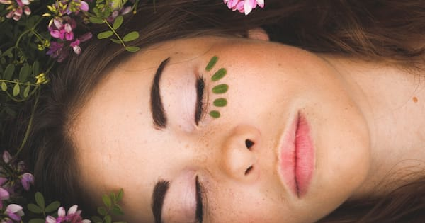 sleeping masks for brightening skin, girl sleeping with perfect skin in nature