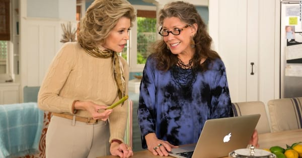 Grace looking at something in shock on Frankie's laptop