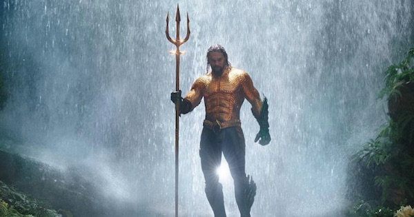 aquaman standing in the rain holding trident, movies 2018