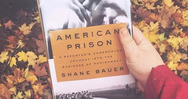 hang holding the book american prisons, 2018 books