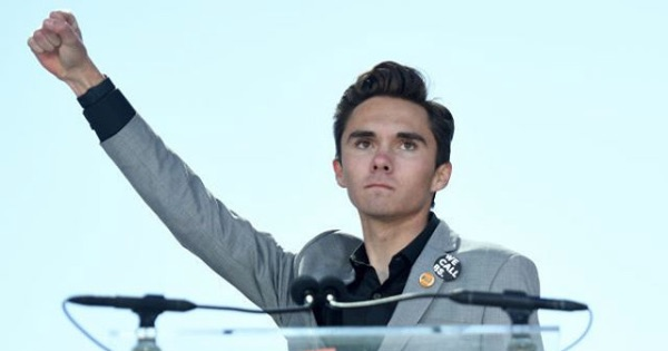 david hogg behind podium with one hand in the hair, 2018 politics