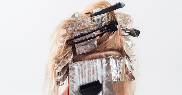 foils in hair with brush applying dye, New Years