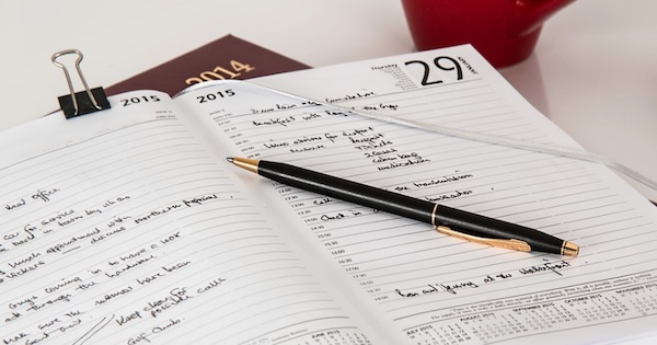 planner on table with a pen and coffee mug, New Years