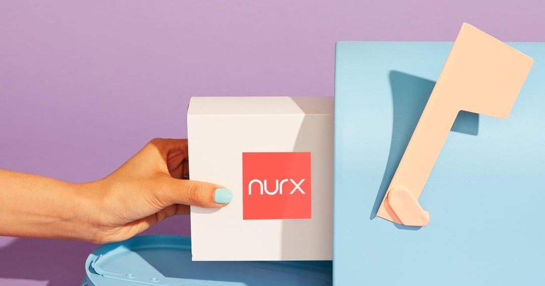 How To Buy Birth Control Online, image of someone pulling their Nurx subscription from their light blue mailbox, health