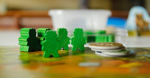 instagram captions for board games, green game pieces on a table
