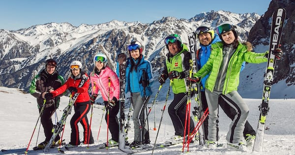 Apres Ski Instagram Captions, a group of friends posing for a photo after skiing, food & drinks, fitness